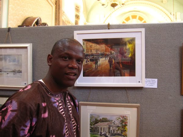 Adebanji with winning painting at the Centenary exhibition with the Chelsea Art Society for The Best London Painting