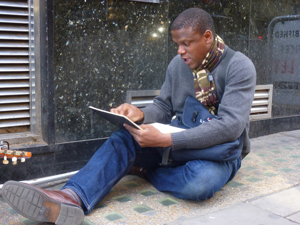 Adebanji Sketching on Charing Cross Road