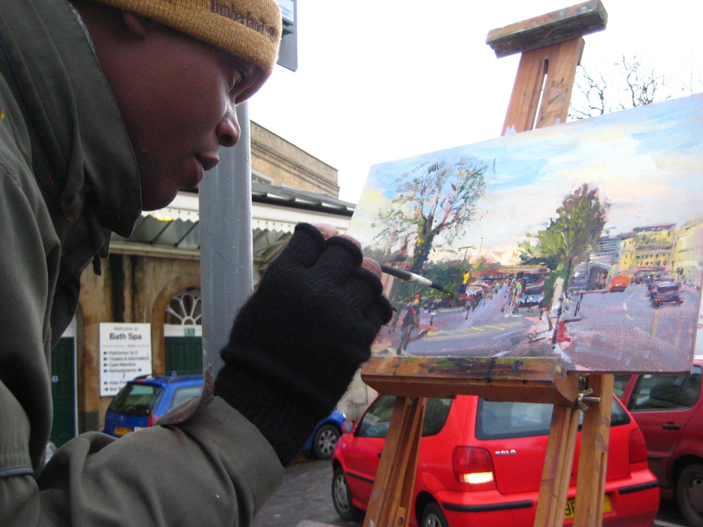 Adebanji painting near Bath Railway Station